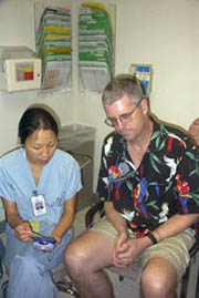 Patient is shown how to use DBS controller